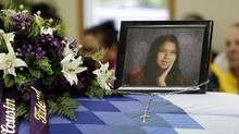 A portrait of Tina Fontaine sits next to flowers on the casket during her funeral on saturday, August 23, 2014. (Lyle Stafford for The Globe and Mail)