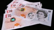 Sample polymer 10- GB pound banknotes are seen on display at the Bank of England in London. (Chris Ratcliffe/Reuters)