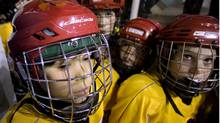 This image is to accompany a story about the start of an alternative hockey league to gthl that will be non-contact. Neil Clifford, one of the founders of the league and his son Phoenix Tashlin Clifford, 12, (at left with green on his helmet), who has suffered four concussions, were at Varsity Arena in Toronto on Wednesday for the final game of the TDESAA Hockey City Championships. Phoenix's team, the Palmerston Panthers, in yellow, defeated the West Rouge Cardinals 2-1 in game that was decided in a shootout after a 1-1 tie in regulation. This game was also non-contact, which is the norm for school hockey at this age. (Peter Power/The Globe and Mail)