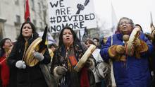 First Nations protesters march towards Parliament Hill before the start of a meeting between chiefs and Canada's Prime Minister Stephen Harper in Ottawa January 11, 2013. (CHRIS WATTIE/REUTERS)