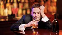 Young drunk man drinking in the bar (Thinkstock)