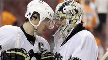 Pittsburgh Penguins' Sidney Crosby, left, and Marc-Andre Fleury celebrate after winning Game 4 in a first-round NHL Stanley Cup playoffs hockey series against the Philadelphia Flyers. (Matt Slocum/Associated Press)