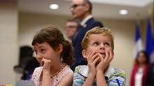 Bryson Boyce-Pettes, 5, right, and Eleonore Alamillo-Laberge, 6, attend a news conference on daycares in Ottawa on Monday. (Sean Kilpatrick/THE CANADIAN PRESS)