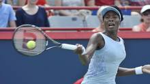 Venus Williams. of the United States, serves to her sister Serena during semi-final play at the Rogers Cup in Montreal on Aug. 9. (Paul Chiasson/THE CANADIAN PRESS)