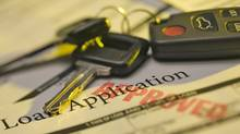 Car keys and approved loan application (Comstock Images/Getty Images/Comstock Images)