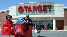 Shoppers come out from the Target store in Boston. (CHITOSE SUZUKI/CHITOSE SUZUKI/AP)