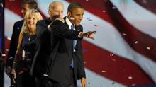 U.S. President Barack Obama celebrates with Vice-President Joe Biden, Jill Biden and their son Beau at the Democrat's election night victory rally in Chicago, Nov. 7, 2012. (JIM BOURG/REUTERS)