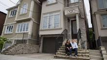 Adam and Ginny Weitner pose for a photograph at their Toronto home on Wednesday, August 20, 2014. The couple purchased the house, near Yonge St. and Eglington Ave., earlier this year for approximately one million dollars. (Matthew Sherwood For The Globe and Mail)