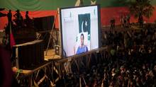 Imran Khan has been forced to address supporters from his hospital bed through video conferencing after falling from a platform at a rally. (MIAN KHURSHEED/REUTERS)