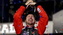 An ecstatic Kurt Busch lifts the Daytona 500 trophy over his head in celebration on Sunday in Daytona Beach, Fla. (Peter Casey/USA Today Sports)