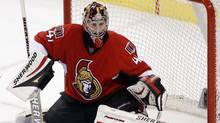 Ottawa Senators' goalie Craig Anderson watches the puck before it flies past him for a Montreal Canadiens' goal during the third period of their NHL hockey game in Ottawa April 7, 2011. (BLAIR GABLE/REUTERS)
