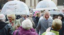 Prince Charles, right, and his wife Camilla are greeted in Charlottetown, P.E.I. on Tuesday, May 20, 2014. (Paul Chiasson/THE CANADIAN PRESS)
