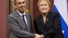 Quebec Premier Pauline Marois poses with Finance Minister Nicolas Marceau as she introduces members of her cabinet after she was sworn in Wednesday, Sept. 19, 2012, at the legislature in Quebec City. (Jacques Boissinot/THE CANADIAN PRESS)