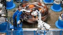 Industrial robot arms at work in the Gestamp Automocion factory branch in Abrera, near Barcelona. (PAU BARRENA/AFP/Getty Images)