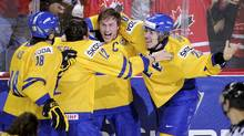 Sweden's Mika Zibanejad, right, celebrates after scoring the gold-medal clinching goal in overtime against Russia. (Todd Korol/Reuters/Todd Korol/Reuters)