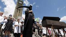 Scientists at Parliament Hill protesting governmental cuts. (FRED CHARTRAND/The Canadian Press)