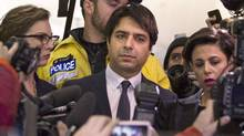 Jian Ghomeshi leaves court in Toronto, Wednesday, Nov.26, 2014. Ghomeshi has been granted bail just hours after being charged with multiple counts of sexual assault. (Chris Young For The Globe and Mail)