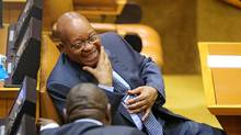 South African President Jacob Zuma laughs ahead of Finance Minister Pravin Gordhan's medium term budget speech in Cape Town, South Africa October 26, 2016. (Sumaya Hisham/Reuters)