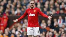 Manchester United's Wayne Rooney reacts in Manchester, northern England, May 6, 2012. (Darren Staples/Reuters/Darren Staples/Reuters)