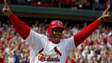 St. Louis Cardinals pinch runner Adron Chambers (56) celebrates his winning run as Chicago Cubs relief pitcher Carlos Marmol (not pictured) throws a bases loaded wild pitch at Busch Stadium. The Cardinals defeated the Cubs 2-1. Scott Rovak-US PRESSWIRE (Scott Rovak/US PRESSWIRE)