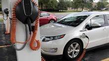 Chevrolet Volt electric vehicles are parked at solar-powered electric charging stations designed by Sunlogics in the parking lot of General Motors Co's assembly plant in Hamtramck, Mich. GM has acknowledged it would miss its target of selling 10,000 Volts in 2011. (REBECCA COOK/REBECCA COOK/Reuters)