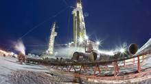 Two Nexen shale gas rigs in the Horn River Basin at Dilly Creek, B.C. CNOOC's $15.1-billion bid for Nexen highlights Canada's continued importance in the Great Scramble for oil. (David Olecko/Nexen)
