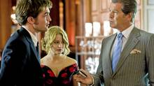 From left, Robert Pattinson, Emilie de Ravin and Pierce Brosnan in the romantic drama Remember Me. (Myles Aronowitz/Myles Aronowitz)
