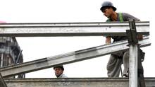 Workers during their daily tasks on a condominium construction site in downtown Toronto, Ontario, Canada. (Deborah Baic/Deborah Baic/The Globe and Mail)