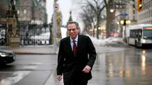 Natural Resources Minister Joe Oliver photograph walking back to his office on Parliament Hill in Ottawa. (Dave Chan for The Globe and Mail/Dave Chan for The Globe and Mail)