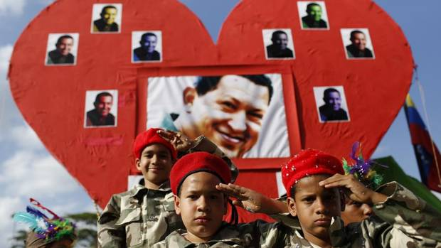 "Children dressed as late Venezuelan President Hugo Chavez salute during the Carnival festival in Caracas March 4, 2014. Venezuela geared up on Tuesday for commemorations of socialist leader Hugo Chavez's death despite continued protests against his successor that have shaken the OPEC member and threatened the legacy of ""El Comandante."" (Carlos Garcia Rawlins/REUTERS)"