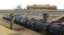 The Association of American Railroads says crude shipped by large North American railways rose to 407,000 cars in 2013, up from 9,500 in 2008. (JIM WILSON/NYT)