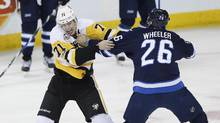 Winnipeg Jets' Blake Wheeler (26) and Pittsburgh Penguins' Evgeni Malkin (71) sqaure off in a first-period fight during last week's game in Winnipeg. (JOHN WOODS/THE CANADIAN PRESS)