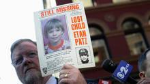 New York Police Department spokesman Paul Brown holds an original missing poster of Etan Patz during a news conference near a New York City apartment building, where police and FBI agents were searching a basement for clues in the boy's 1979 disappearance, in New York April 19, 2012. (Keith Bedford/REUTERS)