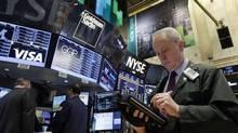 Trader James Riy at the New York Stock Exchange (Richard Drew/AP)