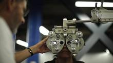 A woman receives an eye exam at the Care Harbor/LA free clinic in Los Angeles, September 27, 2012. (© Lucy Nicholson/REUTERS)
