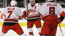 Carolina Hurricanes' Ray Whitney, center, celebrates with teammates Matt Cullen (8) and Niclas Wallin (7) after scoring the game-winning goal during the overtime period of an NHL hockey game against the New York Rangers, Saturday, Jan. 2, 2010, in New York. The Hurricanes won the game 2-1. (AP Photo/Frank Franklin II) (Frank Franklin II)