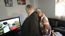 Helena Boky leans on Toronto mayor Rob Ford during his visit to a Toronto Community Housing apartment building on Sept 18 2013. (Fred Lum/The Globe and Mail)