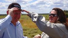 Australias richest woman, mining magnate Gina Rinehart, adjusts a cap for Martin Ferguson, Australia's resources minister, during a visit to the Alpha Coal project test pit in the Galilee Basin about 800 kilometres northwest of Brisbane in this 2010 photo. Tumbling coal prices and tough financing threaten to derail tens of billions of dollars of planned investment in the Basin. (HANDOUT/REUTERS)