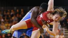 Erica Wiebe of Canada, right, wrestles with Blessing Onyebuchi of Nigeria in a 75kg wrestling bout at the Scottish Exhibition Conference Centre during the Commonwealth Games 2014 in Glasgow, Scotland, Tuesday July 29, 2014. (Kirsty Wigglesworth/AP)