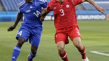Cuba's Aricheell Hernandez (14) and Canada's Russell Teibert (3) vie for the ball in the first half of a CONCACAF Olympic qualifying soccer match on Monday, March 26, 2012, in Nashville, Tenn. (Mark Humphrey/AP)