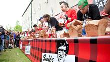 First annual Smoke's Poutinerie World Poutine Eating Championship featuring 13 professional eaters.