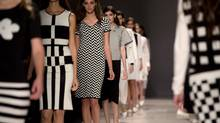 Models walk the runway in the Pink Tartan show, part of Toronto Fashion Week in Toronto on Monday October 21, 2013. (Frank Gunn/THE CANADIAN PRESS)