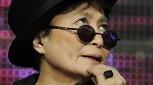 """Yoko Ono ponders a question during a panel discussion on the PBS special """"LennonNYC"""" at the PBS Television Critics Association summer press tour in Beverly Hills, Calif., last week. (Chris Pizzello/AP)"""