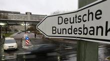 Germany's federal bank, Deutsche Bundesbank, has sharply criticized the European Central Bank's plan to buy the debt of highly indebted states in a confidential report, according to a newspaper account. (KAI PFAFFENBACH/REUTERS)