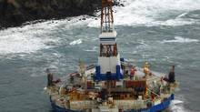 The conical drilling unit Kulluk sits grounded about 65 kilometres southwest of Kodiak City, Alaska in this U.S. Coast Guard handout photo taken Jan. 3, 2012. (US COAST GUARD/Reuters)