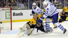 Boston Bruins goalie Tuukka Rask makes a save in front of Toronto Maple Leafs defenceman Dion Phaneuf while Bruins defenceman Dougie Hamilton defends during the third period at TD Banknorth Garden (Bob DeChiara/USA TODAY Sports)