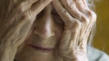 An elderly woman grieves. (Anne de Haas/iStockphoto)