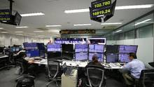 Money traders monitor computer screens with the day's exchange rate between yen and the U.S. dollar at a foreign exchange brokerage in Tokyo, Wednesday, Oct. 5. (Shizuo Kambayashi/AP)