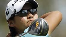 Yani Tseng of Taiwan tees off on the third hole during the third round of the LPGA Kraft Nabisco Championship golf tournament in Rancho Mirage, California April 2, 2011. REUTERS/Danny Moloshok (DANNY MOLOSHOK)