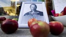 A tribute to Apple Inc., co-founder and former CEO Steve Jobs is left in front of an Apple store in downtown Montreal, October 6, 2011. Jobs died on October 5, 2011 at age 56 of cancer. (CHRISTINNE MUSCHI/CHRISTINNE MUSCHI/REUTERS)